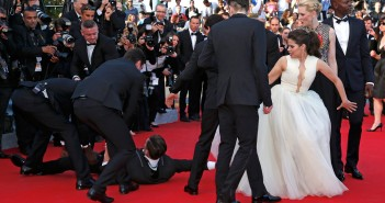"""A man is arrested by security as he tries to slip under the dress of actress America Ferrera (3rdR) as she poses on the red carpet arriving for the screening of the film """"How to Train Your Dragon 2"""" out of competition at the 67th Cannes Film Festival in Cannes May 16, 2014. From R, Cast members Djimon Hounsou, Cate Blanchett, America Ferrera, Kit Harington and Jay Baruchel.                 REUTERS/Benoit Tessier (FRANCE  - Tags: ENTERTAINMENT TPX IMAGES OF THE DAY)"""
