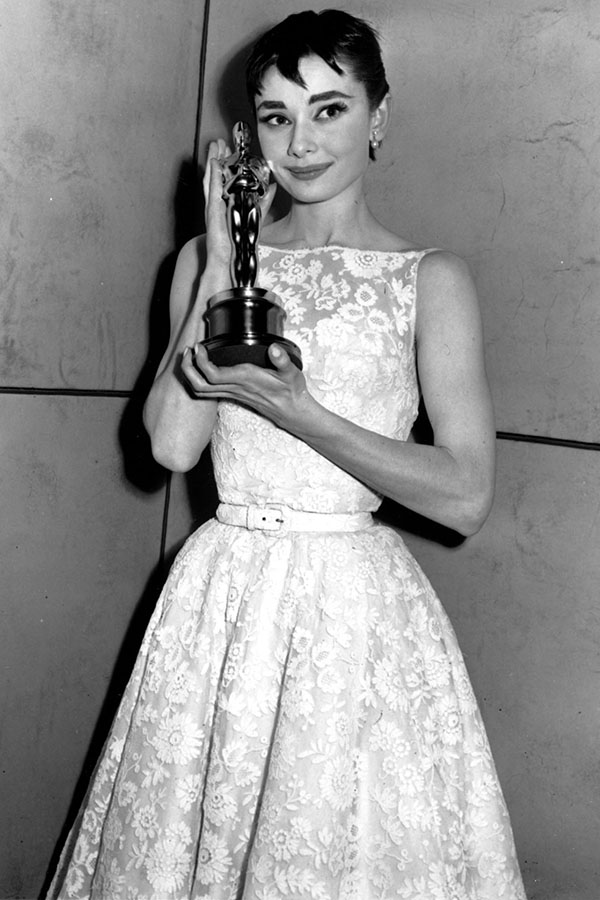 "Oscar-winner Audrey Hepburn poses with her statuette at the 26th Annual Academy Awards ceremony in New York on Hepburn won for best actress for her portrayal in ""Roman Holiday."""